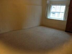 Large 2 bedroom flat above shop in Tetbury town centre.