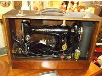 vintage sewing machines in original boxes