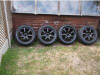 set 4 ,ford 16 inch alloy wheels,refurbed black,,c/w centres c/w 205 x 55 x 16 tyres,5 x 108 pcd