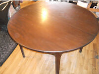 BROWN ROUND DINING TABLE (SUITABLE FOR UP TO SIX PEOPLE)