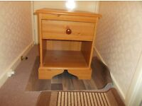 Pine bedside cabinet with drawer.