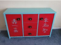 Upcycled sideboard/cabinet, beautifully decorated with chinese motives, hand made knobs.