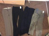 Four pairs of smart trousers size 8. Never worn,