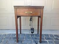 Antique sewing table with sewing machine