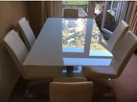 Glass Dining Table & 6 White Faux Leather Chairs. Excellent Condition