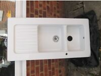 Double ceramic sink in good condition,has two very small chips in the center divider,
