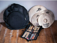 Full cymbal set plus carry case and stick bag.