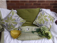 Green curtains and cushions