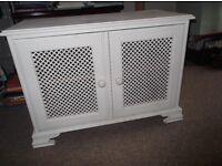 Wooden lattice cupboard with solid shelving £20