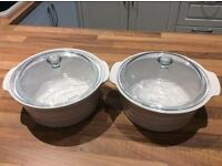 2 white pottery Pyrex casserole dishes with glass lids