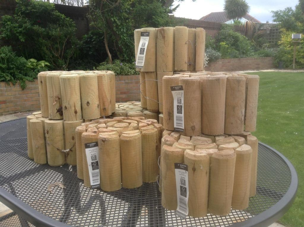 Border log roll for edging your garden in milford on for Log garden edging