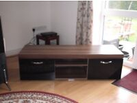 """65"""" T V Stand Mahogany Finish with Two black drop down Doors"""