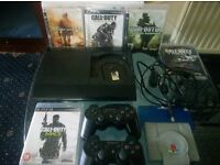 PLAYSTATION 3 (PS3 ) SUPER SLIM 500GB, 2 CONTROLLERS,5 GAMES, WALLET, plus all wires ONLY 95£