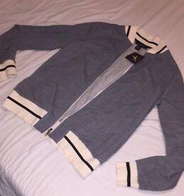 Brand new, grey, black & cream jacket.