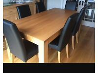 Large table 4 black leather chairs for sale