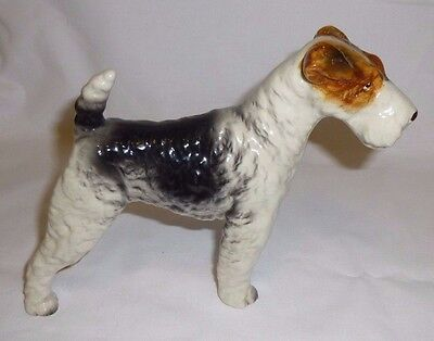 "Schnauzer Porcelain Figurine 5.5"" Tall X 7.25"" Long Excellent Condition No Marks"