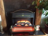 Electric fire heater with light up log effect. 2 settings.