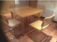 Dining table and 6 Marcel Breuer 'Cesca' style wicker and chrome, cantilever, dining chairs