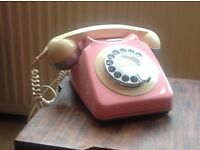 Retro vintage telephone in pink and cream