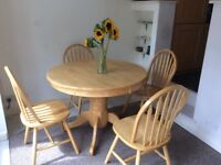 Solid pine, extendible dining table and 4 matching chairs.