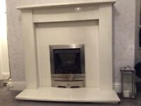 Gas fire with marble effect surround