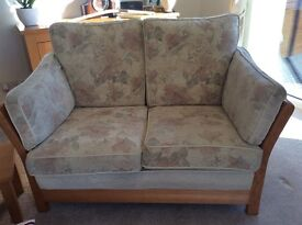 Three piece suite, two seater sofa and two chairs