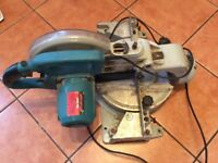 NEILSEN BENCH MITRE SAW IN WORKING CONDITION JUST NEEDS A CLEAN UP