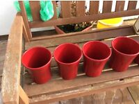 Five red ceramic pots for flowers and plants