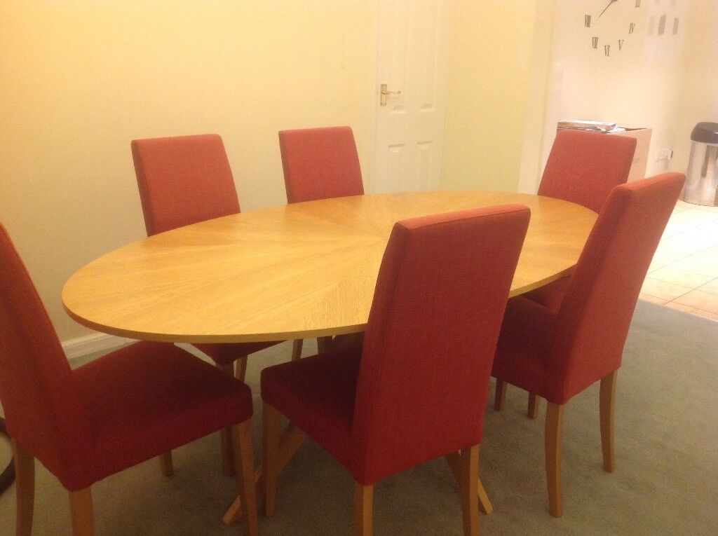 John Lewis light oak 6 seater dining table and 5 red fabric dining chairs