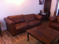 A Laura Ashley Leather sofa(Brown).