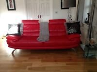 2 x red leather 3 seater sofas and footstool