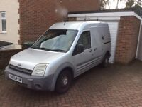 Transit Connect van in Silver with Ply wood Bulk Head and Sliding side door.