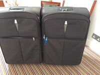 2 x very large gry/black family suitcases