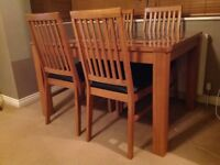 Solid wood dining table with 4 chairs (Harvey's)