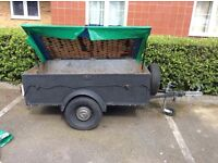 Camping trailer with jockey wheel and spare wheel