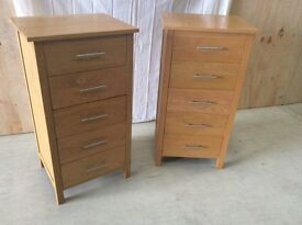 A pair of modern tall light oak good quality chest of drawers