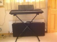 Yamaha PSR 500 keyboard/synthesiser with stand and case.