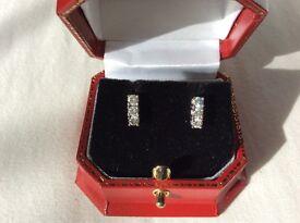 18 ct gold 3 stone diamond earrings 0.5 ct.