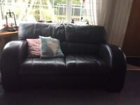 Black Italian leather two seater sofa and armchair originally from dfs