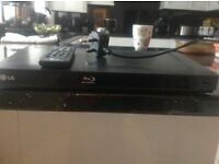 LG BLUE RAY DVD PLAYER USED ONCE WITH REMOTE CONTROL
