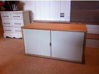Oak wall unit with pale green/olive doors.