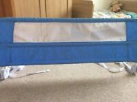 Two blue bed guards in great condition