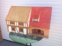 Dolls house, mock tudor style with part thatched roof
