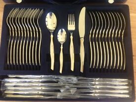 Beautiful, brand new 12 place cutlery set plus a set of 12 matching steak knives both in cases