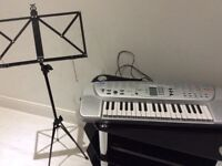 Casio Electric Keyboard. With music paper stand.