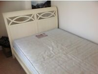 Pretty cream double bed with mattress