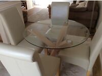 Glass dining table and four cream chairs - new