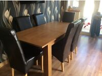 Oak effect extending table with 6 chairs