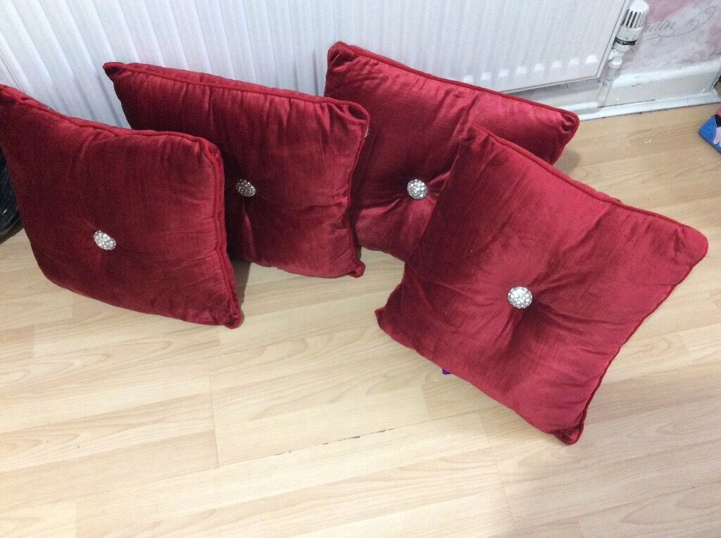Red velvet cushion with brooch