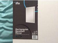 A Rectangular Bevelled Mirror.